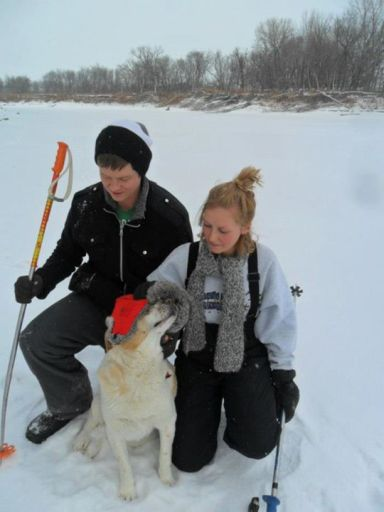 Pappy with my sis and I on the river ice.
